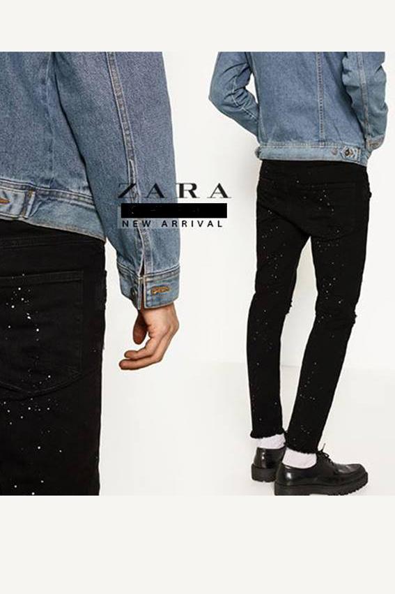 Quần jean nam đen rách vẩy sơn.